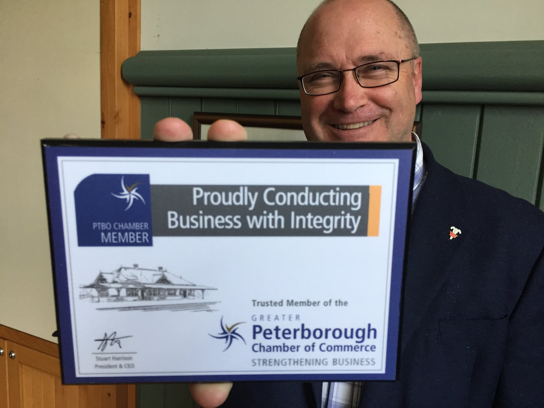 Stuart Harrison with Peterborough Chamber Member plaque:
